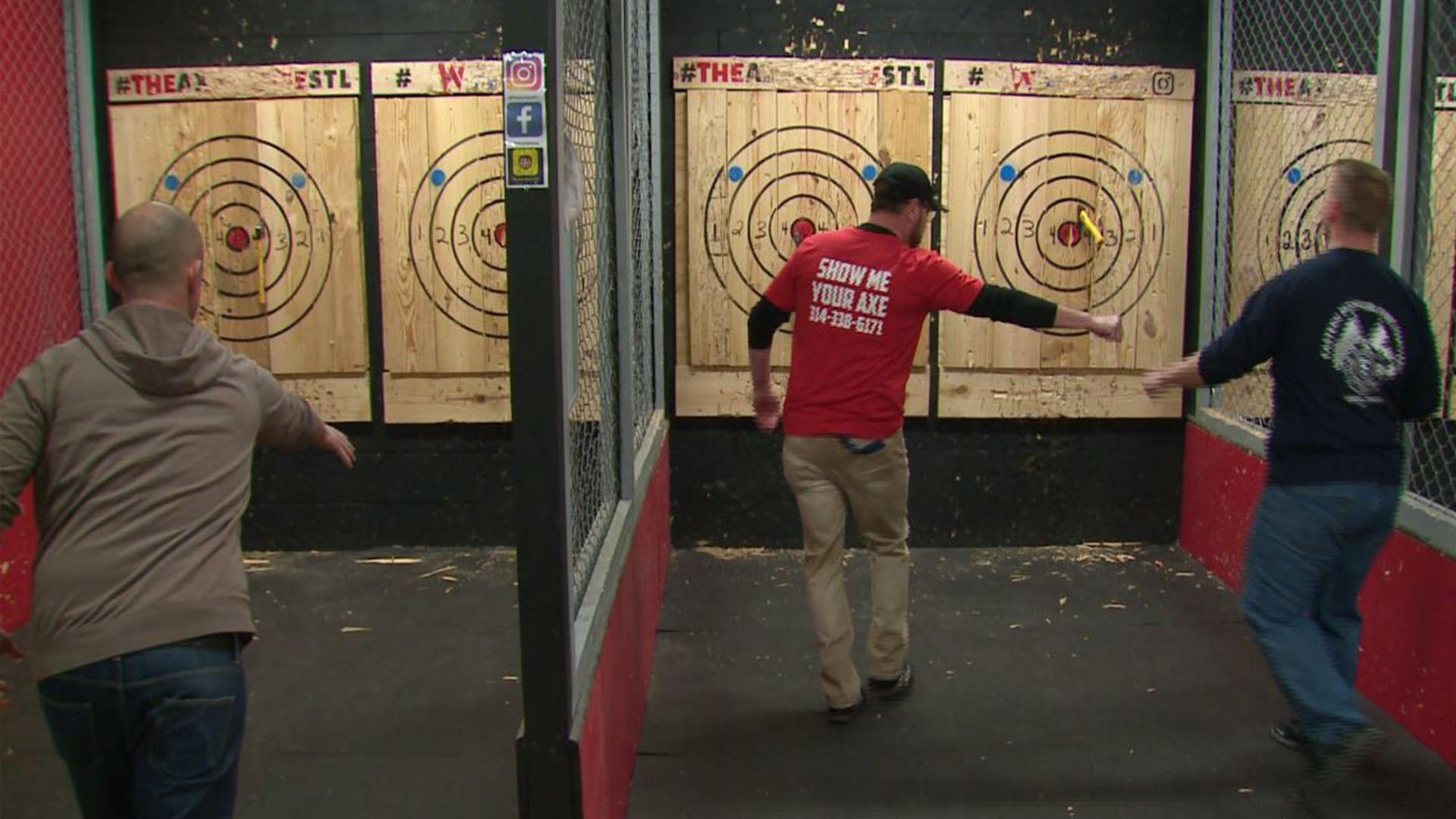 Attendee throw axes to help raise money for a young boy with a rare disease. (Credit: KMOV)