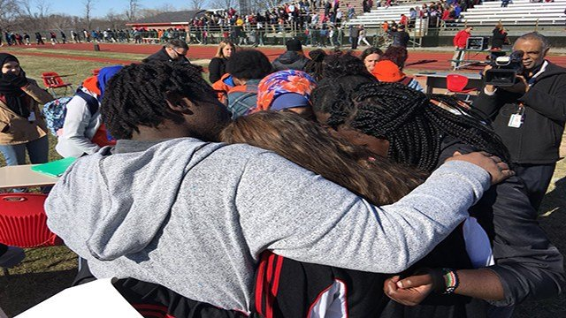 Hazelwood West students embrace each other in tears during walkout. (Credit: KMOV)