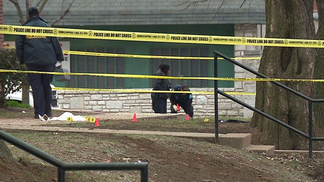 Investigators process the scene where a man was killed in North St. Louis (Credit: KMOV)