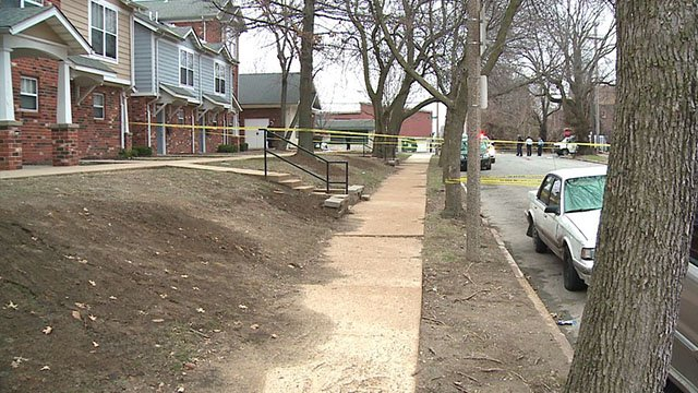 Police tape off a block of McMillan Ave where a man was shot in the neck Saturday (Credit: KMOV)