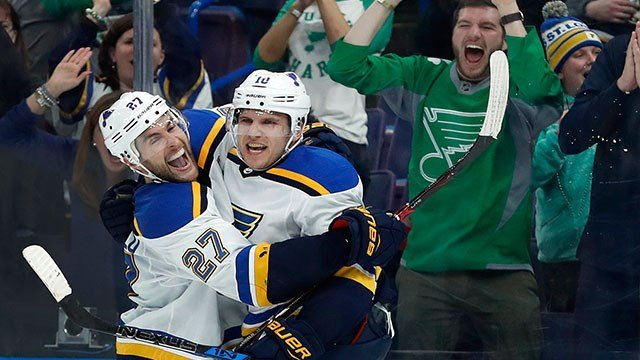 St. Louis Blues' Brayden Schenn is congratulated by Alex Pietrangelo, left, after scoring the game-winning goal in overtime of an NHL hockey game against the New York Rangers Saturday, March 17, 2018, in St. Louis. The Blues won 4-3. (AP Photo/Jeff Robers