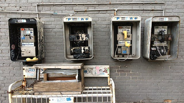 Broken public pay phones are shown, March 10, 2016 in the Brooklyn borough of New York (Credit: AP Photo/Mark Lennihan)