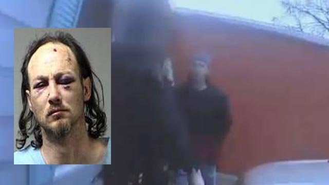 Aaron Summers' mugshot on a still from the video released by police (Credit: KMOV / Police)