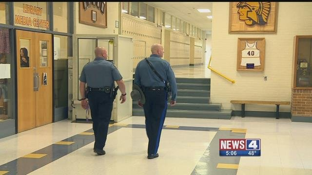 2 Missouri Highway Patrol officers at a school. Credit: KMOV