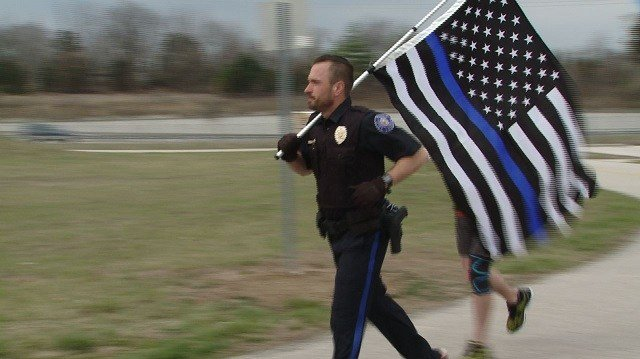 Officer Hughes kicked off his run Friday in St. Charles. He is expected to complete his run across Missouri Saturday, March 31. (Credit: KMOV)