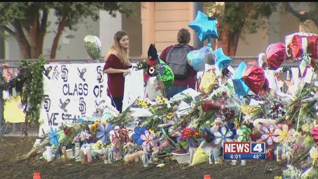 A memorial at Stoneman Douglas High School. Credit: KMOV