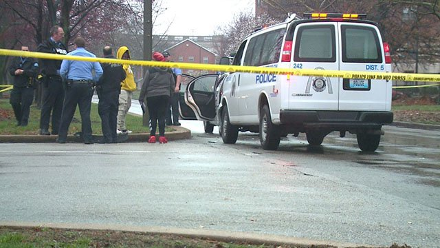 Investigators process the scene where two people were shot in St. Louis ( Credit: KMOV)