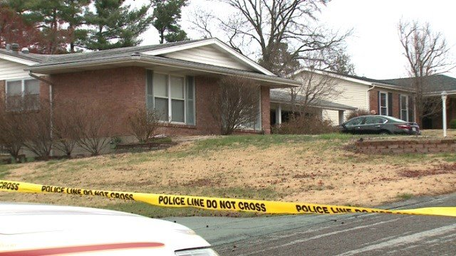 St. Louis County police investigate a home near Creve Coeur where two people were found dead inside. (Credit: KMOV)