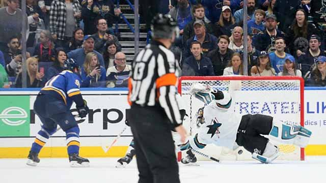 Vladimir Tarasenko, left, scores the game-winning goal past San Jose Sharks goaltender Aaron Dell in overtime on Tuesday, March 27, 2018, at the Scottrade Center in St. Louis. The Blues won, 3-2, in OT. (Chris Lee/St. Louis Post-Dispatch/TNS via Getty)