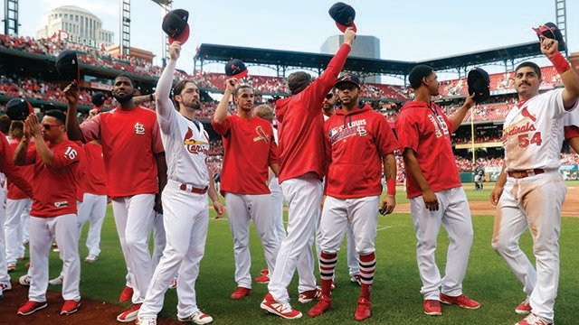 Members of the St. Louis Cardinals wave to fans following a baseball game against the Milwaukee Brewers Sunday, Oct. 1, 2017, in St. Louis. The Brewers won 6-1. (Credit: AP)