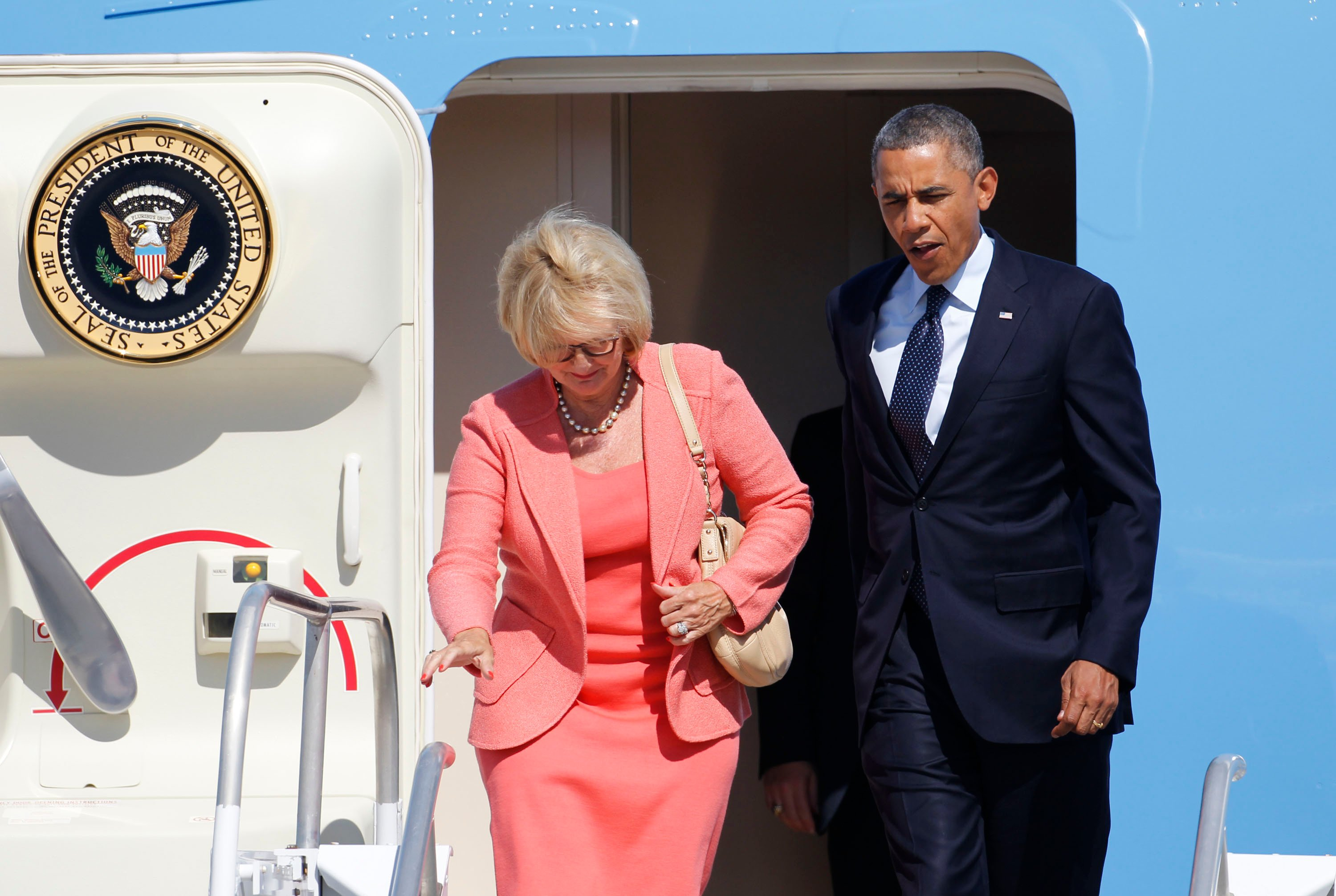 Senator Claire McCaskill (D), Missouri, departs Air Force One with President Barack Obama after arriving at Whiteman Air Force Base in Knob Noster, Mo., Wednesday, July 24, 2013. (AP Images)