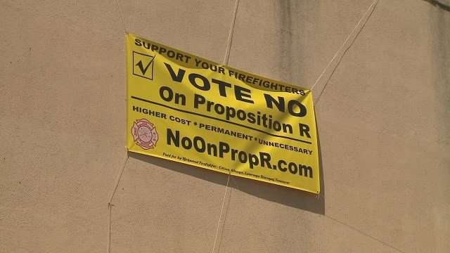 "A ""vote no on Prop R"" sign hangs outside of the Kirkwood Fire Department's building. (Credit: KMOV)"