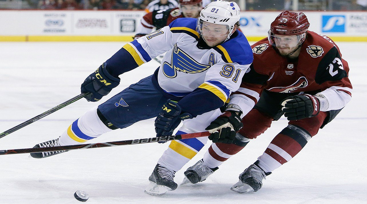 St. Louis Blues right wing Vladimir Tarasenko (91) and Arizona Coyotes defenseman Oliver Ekman-Larsson battle for the puck in the first period during an NHL hockey game, Saturday, March 31, 2018, in Glendale, Ariz. (AP Photo/Rick Scuteri)