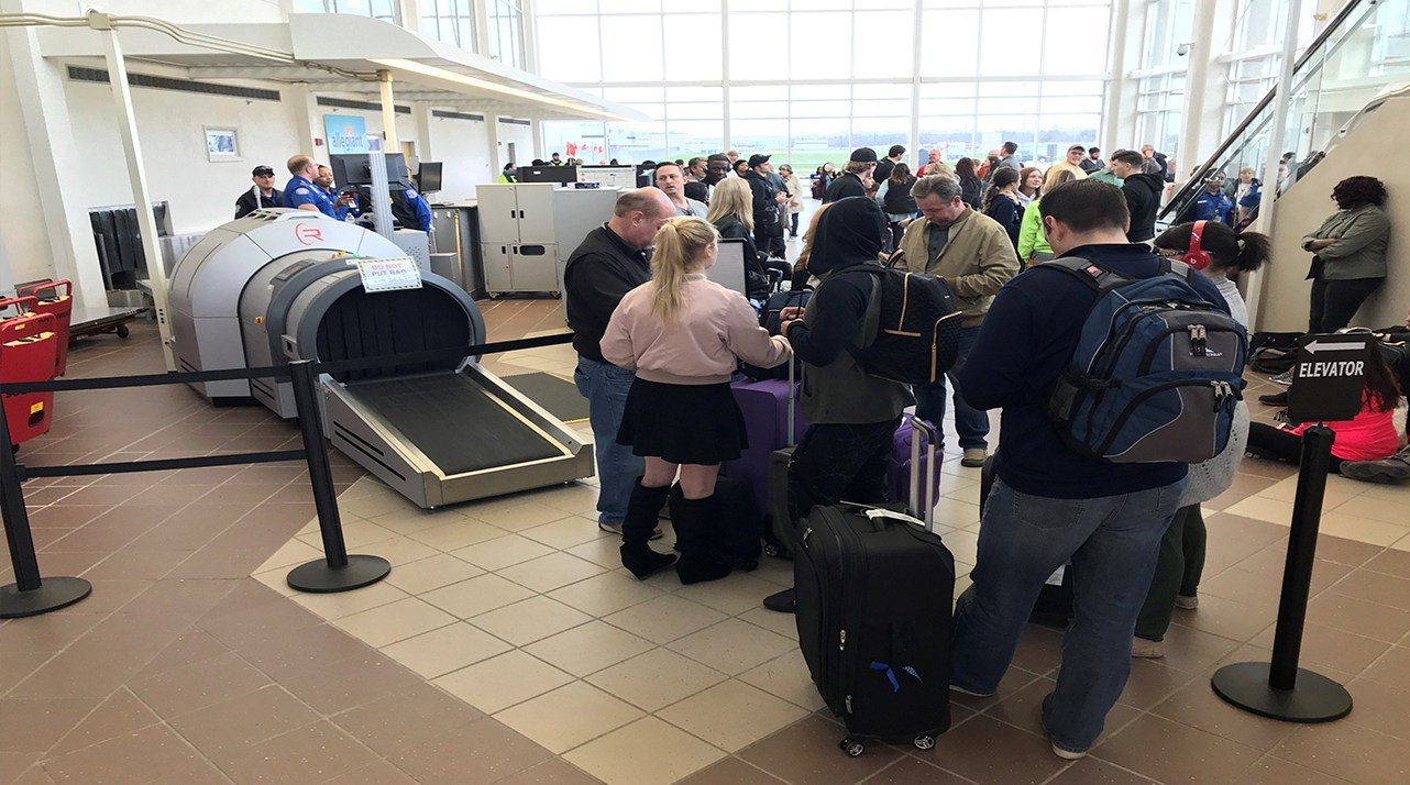 Passengers stand in a terminal area after a safety concern halt a flight at MidAmerica Airport in Mascoutah ( Credit: KMOV)