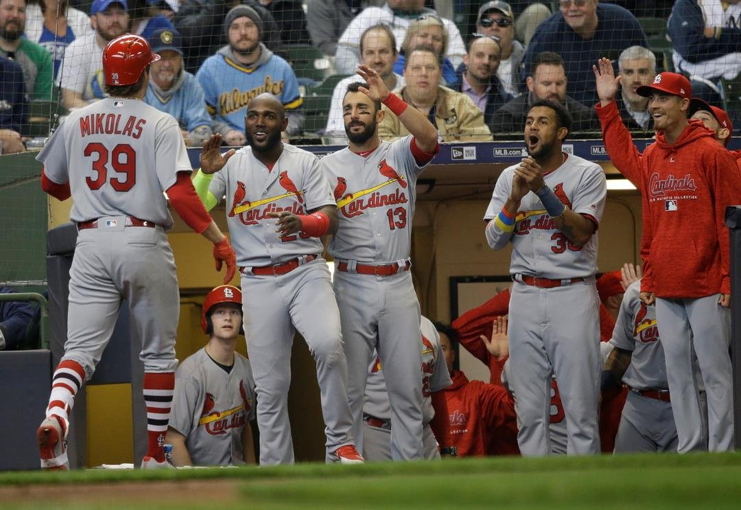 Miles Mikolas (39) is welcomed back to the dugout after his two-run home run during the fifth inning against the Milwaukee Brewers in the home opener baseball game Monday, April 2, 2018, in Milwaukee. (AP Photo/Jeffrey Phelps)