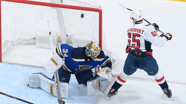 Andre Burakovsky #65 of the Washington Capitals scores a goal against Jake Allen #34 of the St. Louis Blues at Scottrade Center on April 2, 2018 in St. Louis, Missouri. (Photo by Scott Rovak/NHLI via Getty Images)