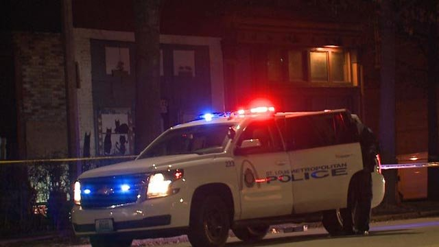 Police vehicle in the 2300 block of South Jefferson after a man was shot Wednesday (Credit: KMOV)
