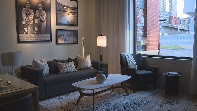 The living room of the Ballpark Village apartments display unit. (Credit: KMOV)