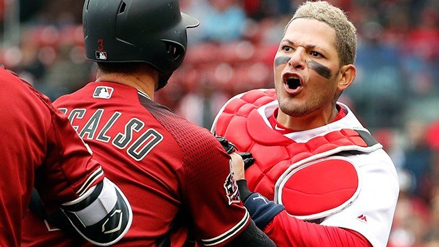 St. Louis Cardinals catcher Yadier Molina, right, is held back by Arizona Diamondbacks' Daniel Descalso while yelling at Diamondbacks manager Torey Lovullo during the second inning of a baseball game Sunday, April 8, 2018, in St. Louis. (AP Photo/Jeff Rob