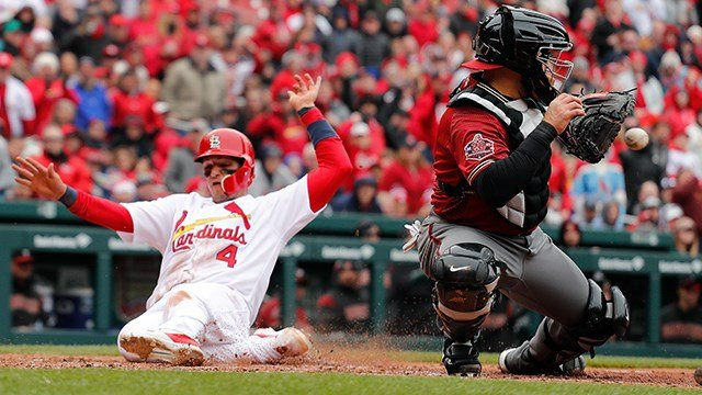St. Louis Cardinals' Yadier Molina scores behind Arizona Diamondbacks catcher Alex Avila on a single by Kolten Wong in the fifth inning of a baseball game on Sunday, April 8, 2018, in St. Louis, Mo. (Chris Lee/ AP)