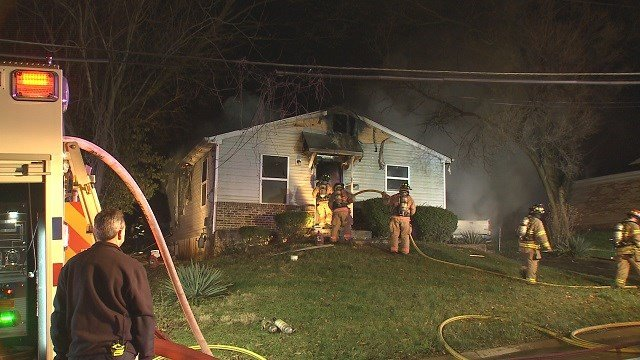 A home in Webster Groves exploded and caught fire late Sunday night. (Credit: KMOV)
