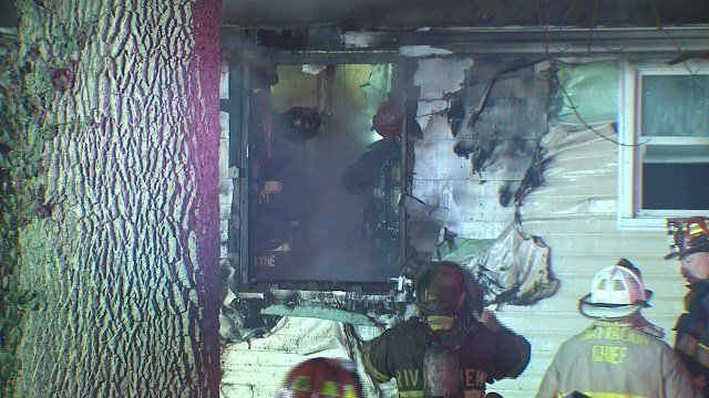 Fire crews battle a house fire in Riverview early Sunday morning. (Credit: KMOV)