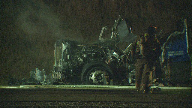A semi-truck was destroyed in a fire on Highway 255 in Godfrey early Tuesday morning. (Credit: KMOV)