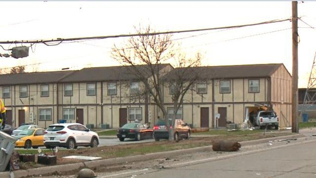 A truck crashed into an East St. Louis apartment building Wednesday (Credit: KMOV)