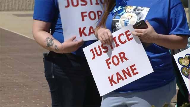 A group gathered outside the St. Clair Co. courthouse Thursday demanding that a man accused of killing a toddler remain behind bars. Credit: KMOV