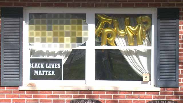 Many neighbors have complained about the sign, but police say no laws have been broken. Credit: KMOV