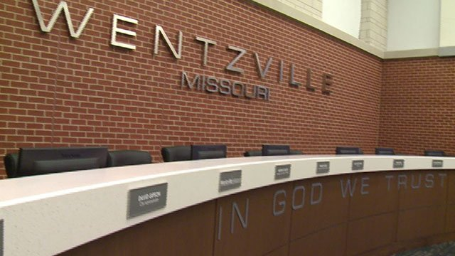 """A lawsuit has been filed over after a woman was thrown out of a city council meeting in Wentzville over the phrase """"In God We Trust"""". (Credit: KMOV)"""
