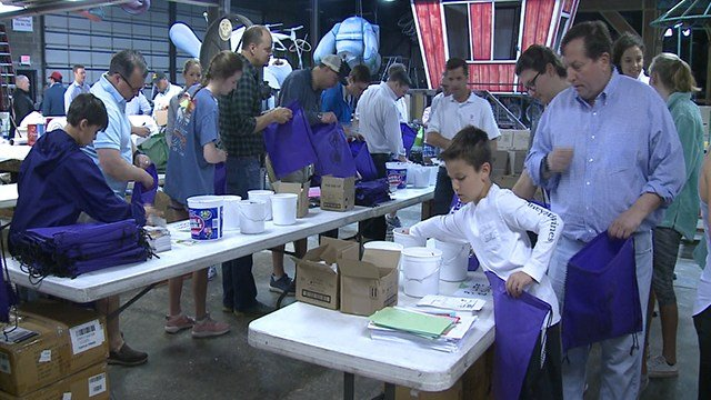 Volunteers create care packages for first responders Saturday (Credit: KMOV)