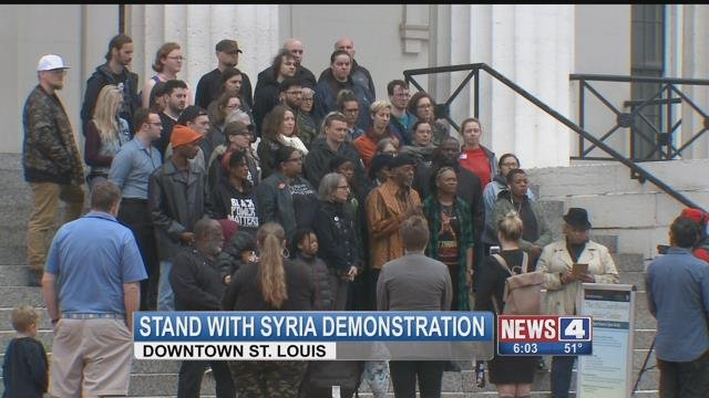 Demonstrators gather at the Old Courthouse to send a message to Syrians. (Credit: KMOV)