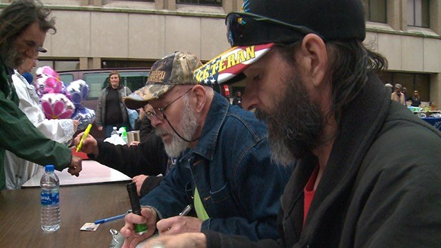 Volunteers help homeless in need of assistance at event in St. Louis ( Credit: KMOV)