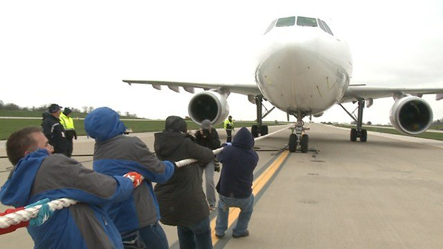 Teams compete for the fastest plane pull to benefit Special Olympics at 'STL Day on the Runway' (Credit: KMOV)