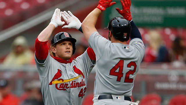 St. Louis Cardinals' Harrison Bader, left, celebrates a two-run home run off Cincinnati Reds starting pitcher Homer Bailey with Greg Garcia, during the second inning of a baseball game, Sunday, April 15, 2018, in Cincinnati. (AP Photo/Gary Landers)