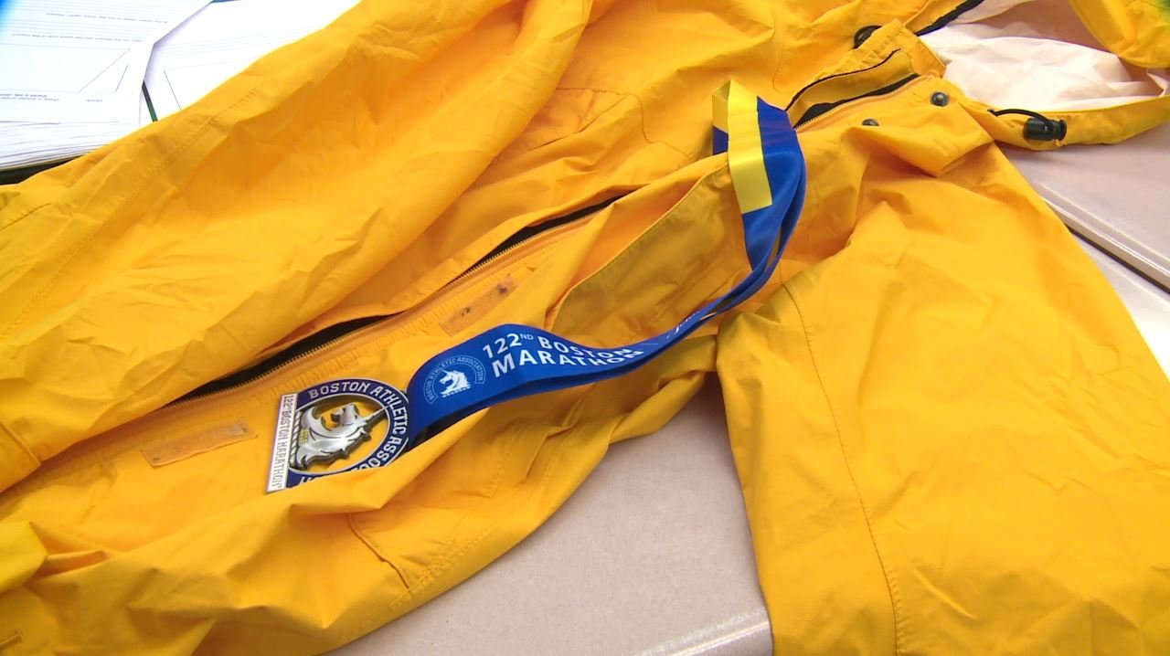 The jacket was given to Stallis by an unknown woman during the Boston Marathon route. (Credit: KMOV)