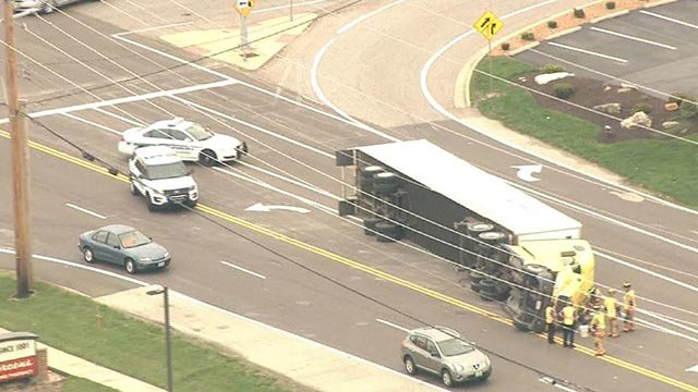 An overturned semi-truck on Chesterfield Airport Road (Credit: KMOV)