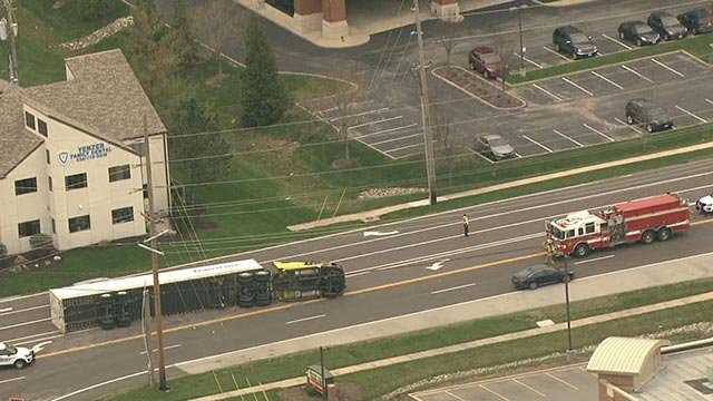 A semi-truck overturned on Chesterfield Airport Road Thursday morning (Credit: KMOV)