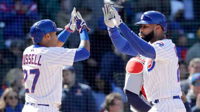 Chicago Cubs' Jason Heyward, right, celebrates his two-run home run off off St. Louis Cardinals relief pitcher Matt Bowman with Addison Russell during the fifth inning of a baseball game Thursday, April 19, 2018, in Chicago. (AP Photo/Charles Rex Arbogast