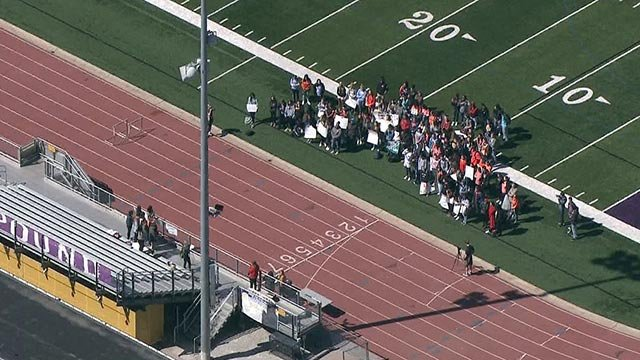 Students on the football field of Eureka High School during a walkout Friday (Credit: KMOV)