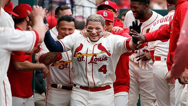 St. Louis Cardinals' Yadier Molina (4) is congratulated by teammates after hitting a solo home run during the seventh inning of a baseball game against the Cincinnati Reds Saturday, April 21, 2018, in St. Louis. (AP Photo/Jeff Roberson)