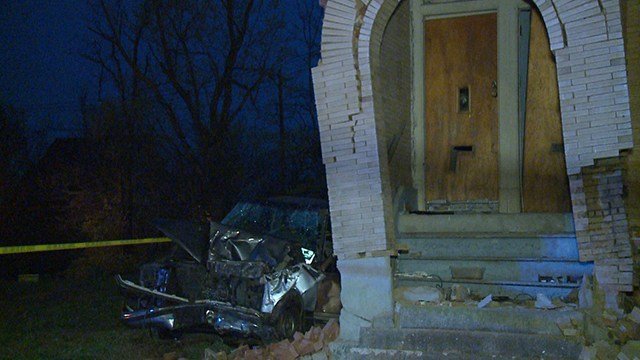 A car crashed into an abandoned building in North St. Louis Saturday ( Credit: KMOV)