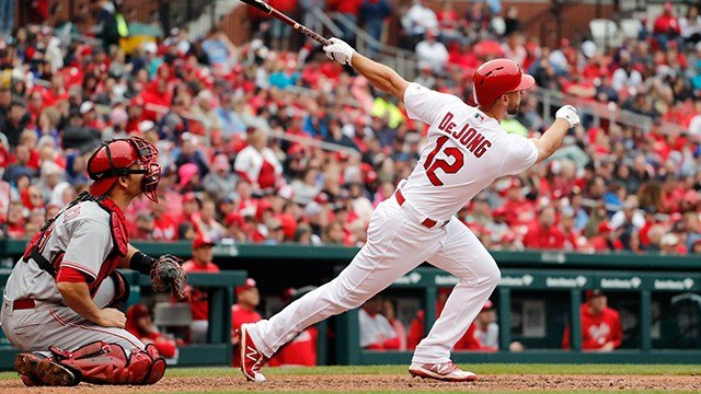 St. Louis Cardinals' Paul DeJong (12) and Cincinnati Reds catcher Devin Mesoraco watch DeJong's three-run home run during the seventh inning of a baseball game Sunday, April 22, 2018, in St. Louis. (AP Photo/Jeff Roberson)