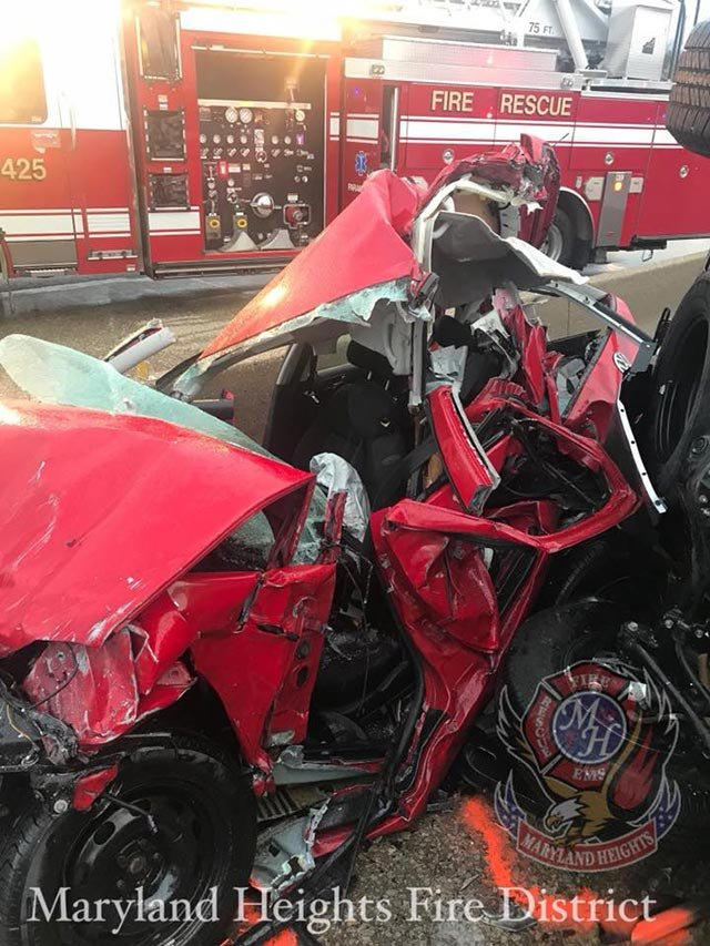 A red vehicle sustained heavy damage during a crash Monday morning on I-270 (Credit: Maryland Heights Fire Protection District)