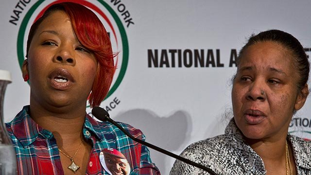 Esaw Snipes, right, the wife of police victim Eric Garner, listens as Lesley McSpadden, left, the mother of police shooting victim Michael Brown, speaks during a panel on police brutality (Credit: AP Photo / Bebeto Matthews)