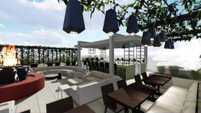 Renderings show a patio bar featuring a fire pit, couches and chairs.  Credit: Gerard Craft
