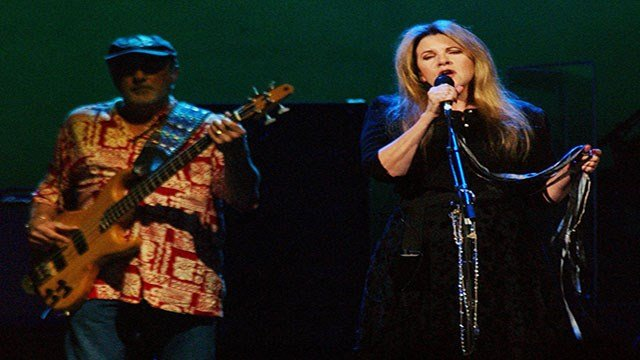 Fleetwood Mac members performing (L-R): John McVie and Stevie Nicks, Columbus, Ohio, (Credit: AP)