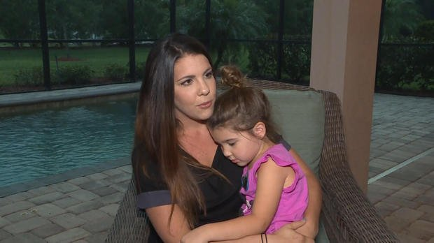 "Lacey Grace holds her 4-year-old daughter Eliana, who almost died from ""dry drowning."" WTSP"