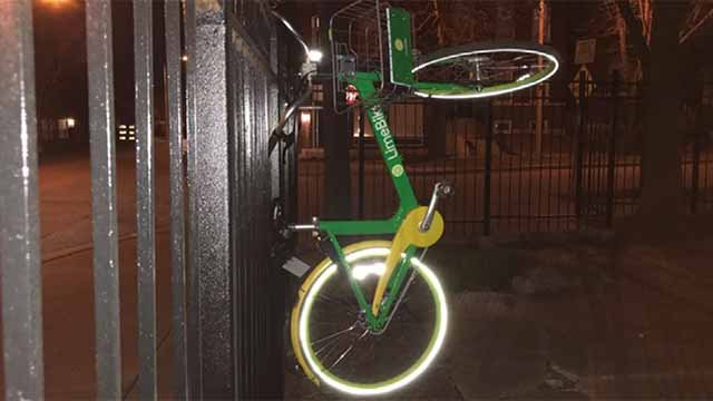LimeBike hanging from a fence. Credit: KMOV